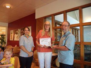 Joanna Van Den Wildenberg receiving her First Prize from Mel at Waitrose