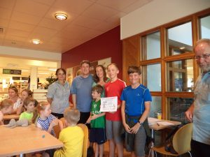 the Cooke Family receiving their Second Prize from Mel at Waitrose