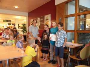 Ben, Oliver and Eloise receiving their Joint Third Prize from Mel at Waitrose