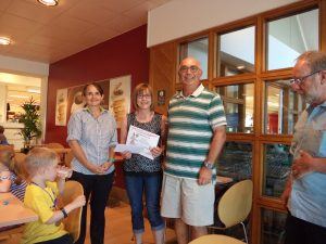 Rachael Burrows receiving her Joint Third prize from Mel at Waitrose