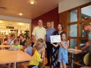 RJL IFA presenting prize for Cuddliest Scarecrow to the Tait Family